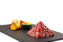 Tar-tar beaf meat pyramida view Royalty Free Stock Image