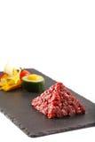 Tar-tar beaf meat pyramida view Stock Photos