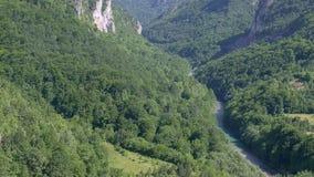 Tara canyon bridge Durdevica above Tara river Montenegro. Tilting camera motion through Tara canyon along river between. Huge mountines stock video footage