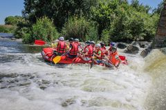 Rafting team , summer extreme water sport. stock photos