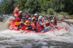 Rafting team , summer extreme water sport. stock image