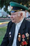 Elderly man with orders and medals. Tara, Omsk region, Russia. A veteran of the Great Patriotic War stock photography
