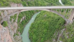 Tara river canyon. Most popular place for visit is the Durdevica bridge. Jurjevich Bridge in Zabljak, Montenegro stock video