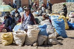 Unidentified indigenous native Quechua market traders selling fruit and vegetables at the local Tarabuco Sunday Market, Bolivia. TARABUCO, BOLIVIA - AUGUST 06 Royalty Free Stock Image