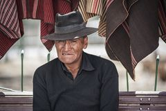 Unidentified indigenous Yampara man with traditional clothing and hat, on the local Tarabuco Sunday Market, Bolivia, South America. TARABUCO, BOLIVIA - AUGUST 06 Stock Images