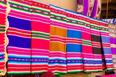 Tarabuco traditional market, Bolivia. Tarabuco traditional market view, Bolivia. Colorful blankets background Royalty Free Stock Photos