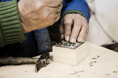 Taracea craftsman. The hands of a craftsman working wooden boxes typical of Granada Stock Image