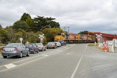 Road rail bridge at Taramakau River. TARAMAKAU RIVER, NEW ZEALAND, NOVEMBER 18, 2017: A freight train holds up traffic at the historic road-rail bridge across Royalty Free Stock Photo