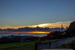 Taranaki Coast, New Plymouth, NZ. Sun setting over the Taranaki Coast, New Plymouth, New Zealand, Aotearoa Stock Images