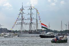 The Tarangini tall ship among spectators on the Ij river. Ij River, Amsterdam, the Netherlands - August 19, 2015: The Tarangini tall ship (India) on the Ij river Royalty Free Stock Photography