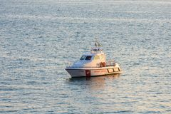 Taranto, Apulia / Italy - 03/25/2019 : A coast guard boat  is guarding the coast of Taranto at sunset on a warm spring afternoon stock images