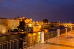 Taranto swing bridge on the taranto canal boat at night. Taranto swing bridge on the taranto canal boat illuminated by lights at night Royalty Free Stock Image
