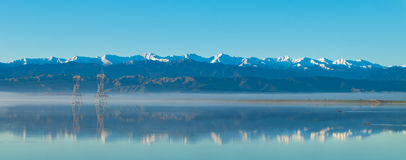 Tararua Rangers Winter Reflection. Taraua Rangers on a clear still morning, with reflection of the Whirokino floodway Royalty Free Stock Image