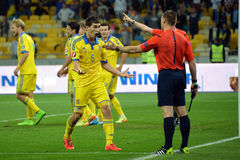 Taras Stepanenko is arguing with the referee Royalty Free Stock Photos