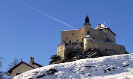 Tarasp Castle on a snowy hill on a clear sunny winter day, Switzerland royalty free stock images