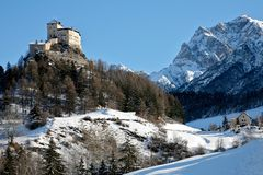 Tarasp Switzerland mountains in the winter. Mountains with snow in the winter in Switzerland with a beautiful castle Royalty Free Stock Photo