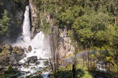 Tarawera falls with rainbow gushing out of fissures in the cliff. Rotorua, New Zealand royalty free stock photo