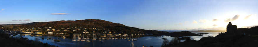 Tarbert and Bruce's castlew at sunrise. Panorama of Loch Fyne, Bruce's castle and Tarbert Harbor in Scotland at sunrise royalty free stock image