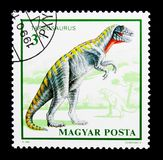 Tarbosaurus, Dinosaurs serie, circa 1990. MOSCOW, RUSSIA - NOVEMBER 24, 2017: A stamp printed in Hungary shows Tarbosaurus, Dinosaurs serie, circa 1990 Stock Images