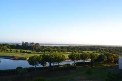 Tarde Sun no campo de golfe Imagem de Stock Royalty Free