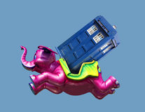 Tardis breakdown recovery. Photo of the dr who and tardis getting a lift from a passing pink elephant after technical breakdown Royalty Free Stock Photography