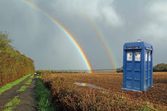 Tardis lands in meadow with rainbow Stock Photography