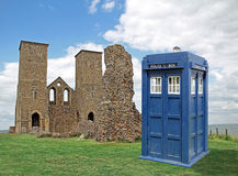 Tardis visits historic reculver towers. Photo of dr who tardis time machine visiting historic site of roman reculver towers in kent Stock Photo