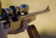 On target. Taking aim at a target with a high powered 30-06 rife Royalty Free Stock Photography