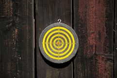 Target. Yellow target on the wood background Royalty Free Stock Image