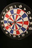 On target. Dartboard with bull's-eye royalty free stock photography