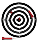 Target. Black and white striped target with four red dart - hit one in the center of the target Royalty Free Stock Photos