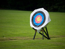 On Target. An archery target range in a field of green grass royalty free stock photo