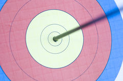 On target. An arrow hitting dead center on a target stock photo