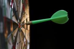 On the Target. Green dart hitting the target stock photo