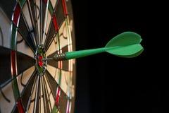 On the Target. Green dart hitting the target Stock Image