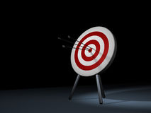 Target. In dark room. Three arrow in . Hit the mark Stock Images