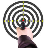 Target. Pistol in a hand of the man against a target stock photos