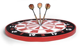 On target. Darts hitting bullseye on white background Royalty Free Stock Photo