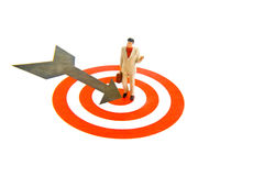 On Target. Miniature business man standing on bulls eye Stock Images