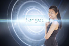 Target against black background with glowing circle Stock Photos