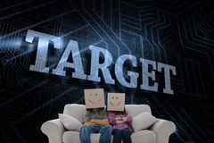 Target against futuristic black and blue background Stock Photos
