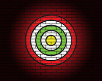 Target or aim, illumination, red brick wall Stock Images