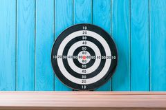 Target arrow on wood floor background Business concept Royalty Free Stock Photos