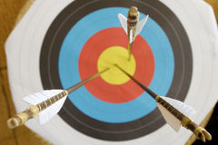 Target and arrows. Three arrows in the center of a dartboard Stock Photo