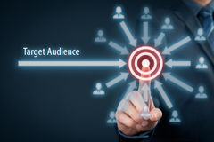 Target audience. Concept. Businessman click on target, audience pointing to target is around target royalty free stock images