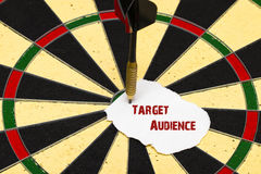 Target Audience. Darts with dart which was pinned a sheet of pap Stock Photos