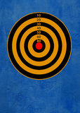Target on blue. Dartboard against blue wall background Royalty Free Stock Image