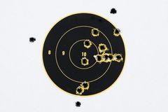 Target With Bullet Holes. Round black and yellow target, isolated on white background, riddled with .223 ammunition bullet holes Stock Images