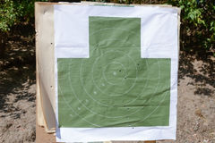 Target with bullet holes on the shooting range. Image of target with bullet holes on the shooting range Stock Image