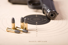 Target bullets and pistol Stock Images
